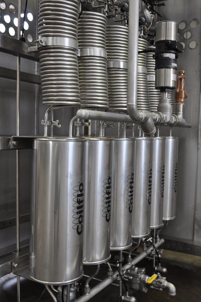 Coilflo Mini Heat Exchangers in a ThermPro Pasteuriser processing fruit juice water ice.